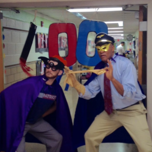 2 men dressed in capes with zeros on them