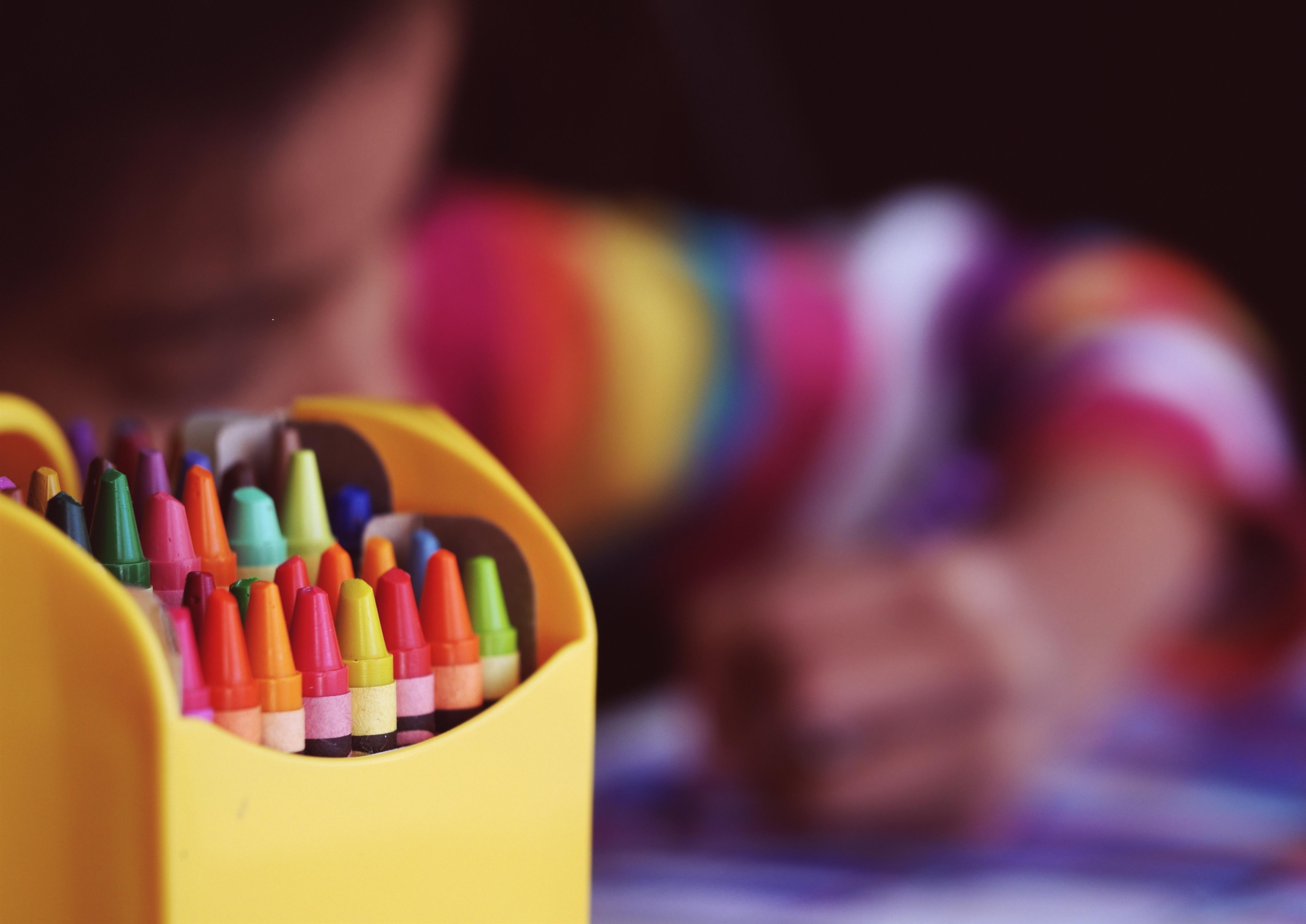 box of crayons boy in backrgound